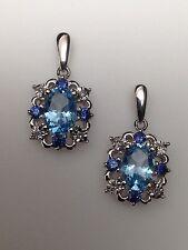 10k Oro Blanco Forma Ovalada Topacio Azul, Iolita y Diamante Pendientes Largos