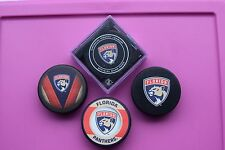 Florida Panthers NHL Licensed Souvenir and Game Puck Set  (Four pucks in all)