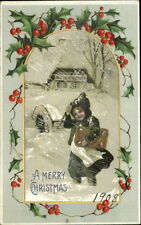 Christmas - Boy in Snowstorm Carrying Package c1910 Postcard
