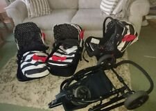Cosatto giggle travel system black and white stripes with red bow