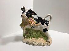 CERAMIC COW JUMPING ON GREEN GRASS FIGURINE
