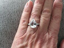 LARGE PETALITE SOLITAIRE RING-SIZE O-4.250CTS-WITH PLATINUM