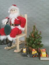 Santa Claus figurines tree and Pixar toys Christmas display children