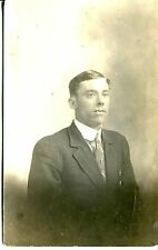 REAL PHOTO POSTCARD OF A MAN TAKEN IN A STUDIO 1910-1920 ERA IS MY GUESS