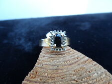 10K. YELLOW GOLD RING WITH EMERALD CUT DARK BLUE SAPPHIRE 3.4 GRAMS .50 CTW.