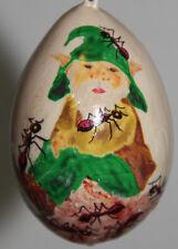 gourd Easter egg, garden or Christmas ornament with elf resting on anthill
