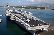 Photo of Tug boats push aircraft carrier USS John C. Stennis  at Pearl  Harbor