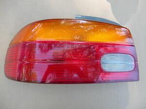 1998-99-2000-01-02 CHEVROLET/GEO PRIZM - OEM OUTER LEFT DRIVER TAIL LIGHT