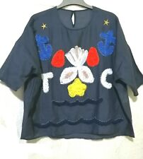 Navy loose  top with rosette details