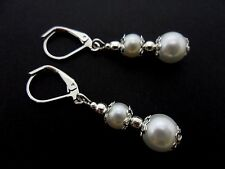A PAIR OF WHITE GLASS PEARL LEVERBACK HOOK  EARRINGS. NEW.