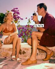 Lex Barker Taking Photo of Lana Turner in Palm Springs
