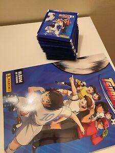 50 pochettes + album panini vide captain tsubasa / olive et tom neuf
