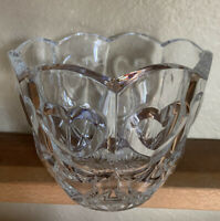 Clear cut glass bowl with scalloped edges and hearts.  Beautiful