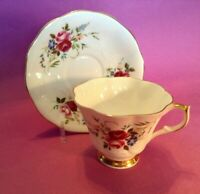 Queen Anne Pedestal Tea Cup And Saucer - Pink Roses And Blue Petunias - England