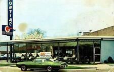 Photo. 1960s. Detroit, Michigan. Jim Causley Pontiac - Auto Dealership