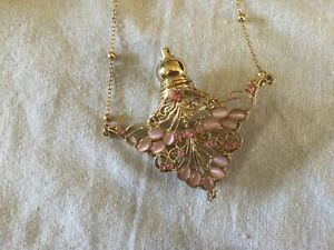 perfume bottle necklace pale pink and gold filigree style