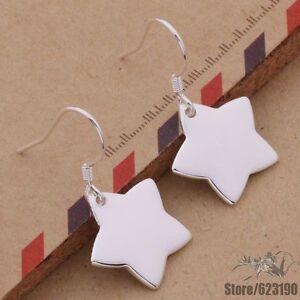 Gorgeous Silver Curved Star Drop Earrings Pentagram Shooting Wish Halloween