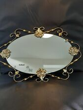 Ornate oval mirror in an Gold Metal Frame
