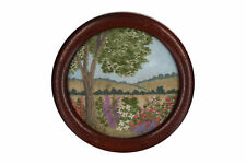 A small hand worked needlework picture Flowers in a Landscape Framed