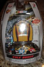 1/64 KYLE BUSCH M&M'S 2010 TOYOTA WINNERS CIRCLE IN PACKAGE