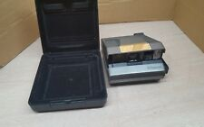 Vintage 1980s Polaroid Spectra System Onyx camera with plastic case