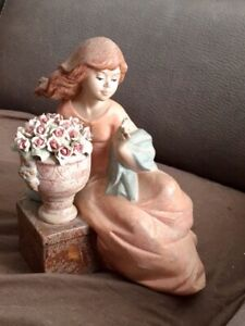 Nadal Girl lying down with flowers Porcelain Figurine From Spain.