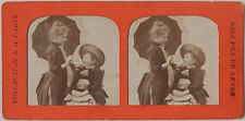 Original vintage 1870s tissue stereoview genre, girls with umbrella