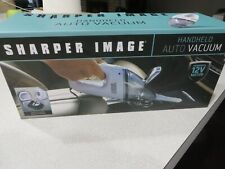 New In Box; sharper image handheld auto vacuum-Bagless Design 12V Power
