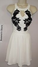 NWT BEBE ANELLE HALTER NECK DRESS SIZE M Stand out wearing our Halter dress $32