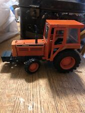 Orange Kubota M Type in a 1:20 scale Die-cast Tractor manufactured by Yonzeawa.