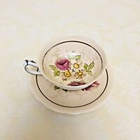 Paragon Light Peach Floral Teacup and Saucer Double Warrant