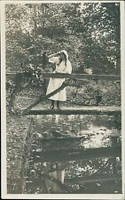 Young lady bridge woodland river scenic hood long hair vintage    QS.169