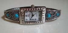 Designer Style Woman stretchy band silver finish / Turquoise Fashion  watch