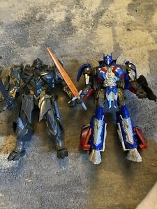 Transformers The Last Knight Voyager Class Premier Optimus Prime and Megatron