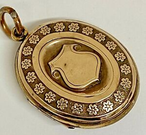 ANTIQUE GOLD CASED KEEPSAKE LOCKET WITH SHIELD & FORGET ME NOT DECORATION