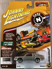 JOHNNY LIGHTNING 1984 OLDS CUTLASS CAR N DONUTS 1 OF 2980 GRAY RR TIRES.