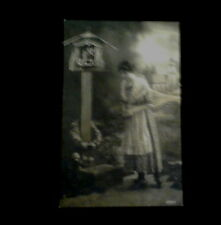 Vintage Postcard of a Woman visiting a Shrine