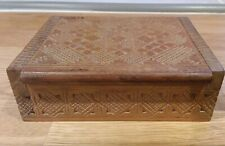 An intricately Carved Wooden Cigarette Case / Trinket Box
