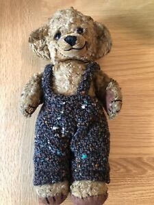 VINTAGE BELIEVED TO BE MERRYTHOUGHT TEDDY BEAR JOINTED WITH A BELL IN EACH EAR.