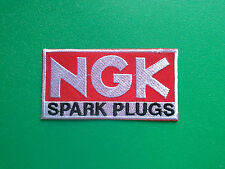 MOTOR RACING OILS, FUELS & TYRES SEW ON / IRON ON PATCH:- NGK SPARK PLUGS RED b