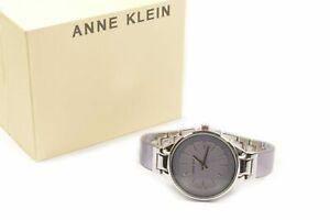 Anne Klein AK1409LVSV Swarovski Crystal Accented Resin Lavender Dial Ladies B...