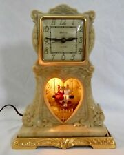 Vintage United Sweethearts Swinging Bakelite Electric Clock.Works Well. NYC 1940