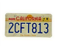 Vintage California Sun The Golden State Sunset License Plate with a 1988 Sticker