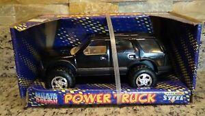 1995 Starkid Chevy S-10 Blazer black SUV truck goodyear pressed steel 1/25 promo