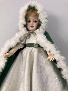 Bleuette: Winter White Silk Gown And Emerald Green Fur Trimmed Cape