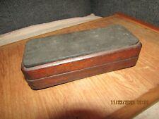 Vintage unbranded wooden framed knife blade sharpening stone.