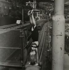 Helmut Newton, woman doing handstand, Bordighera, Italy 1996, Matted PHOTOLITHO