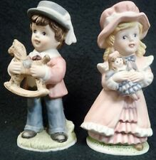 pair of vintage Boy & Girl Porcelain Figurines with number markings