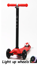 Maxi Scooter (Maxi/micro style) LIGHT UP WHEELS. RED Boxed Tilt n Turn 4-12yrs