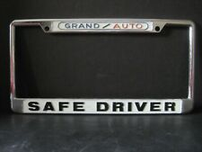 Vintage Grand Auto Parts Supply Store Safe Driver Metal License Plate Frame NOS